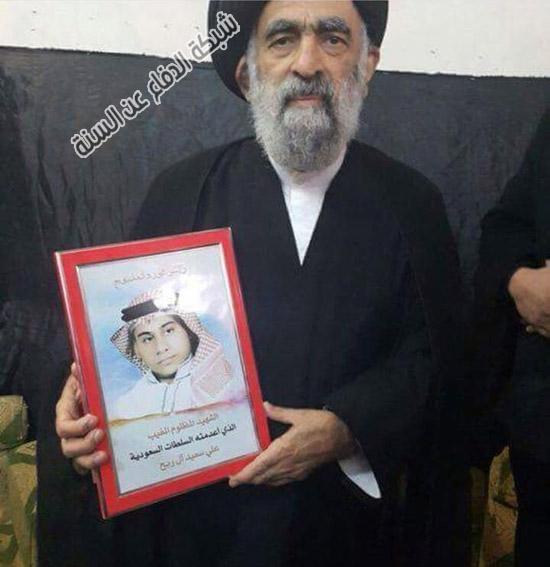 المعمم محمد هادي المدرسي يحمل صور الإرهابيين والقتلة ويدافع عنهم